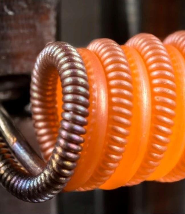 Волочильщик материала для спиралей